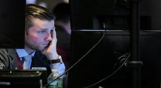 Traders work on the floor at the New York Stock Exchange (NYSE) in New York City, U.S., November 20, 2018. REUTERS/Brendan McDermid