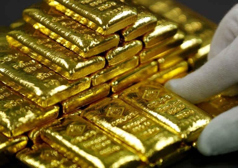 Gold firms on doubts over Fed rate path; focus on G20