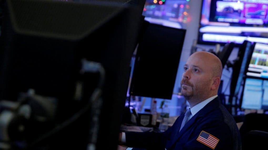 Wall Street slips as financials drag, trade outlook clouds