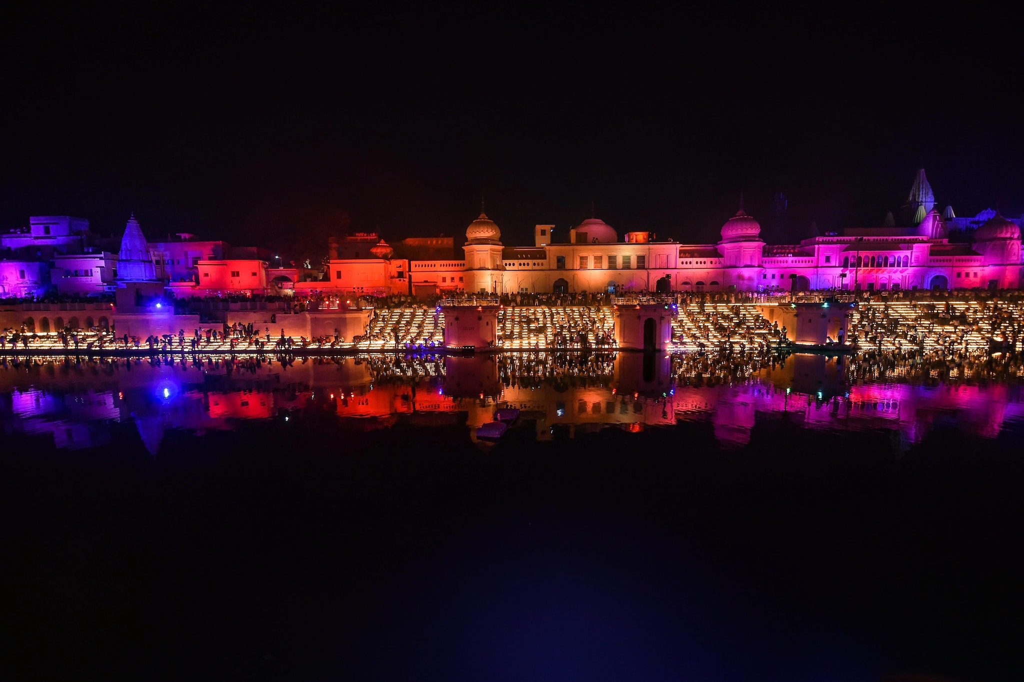 People light earthen lamps on the banks of River Saaryu during Deepotsav (grand Diwali celebrations) in Ayodhya, Tuesday, Nov 6 2018. (PTI Photo/Nand Kumar)