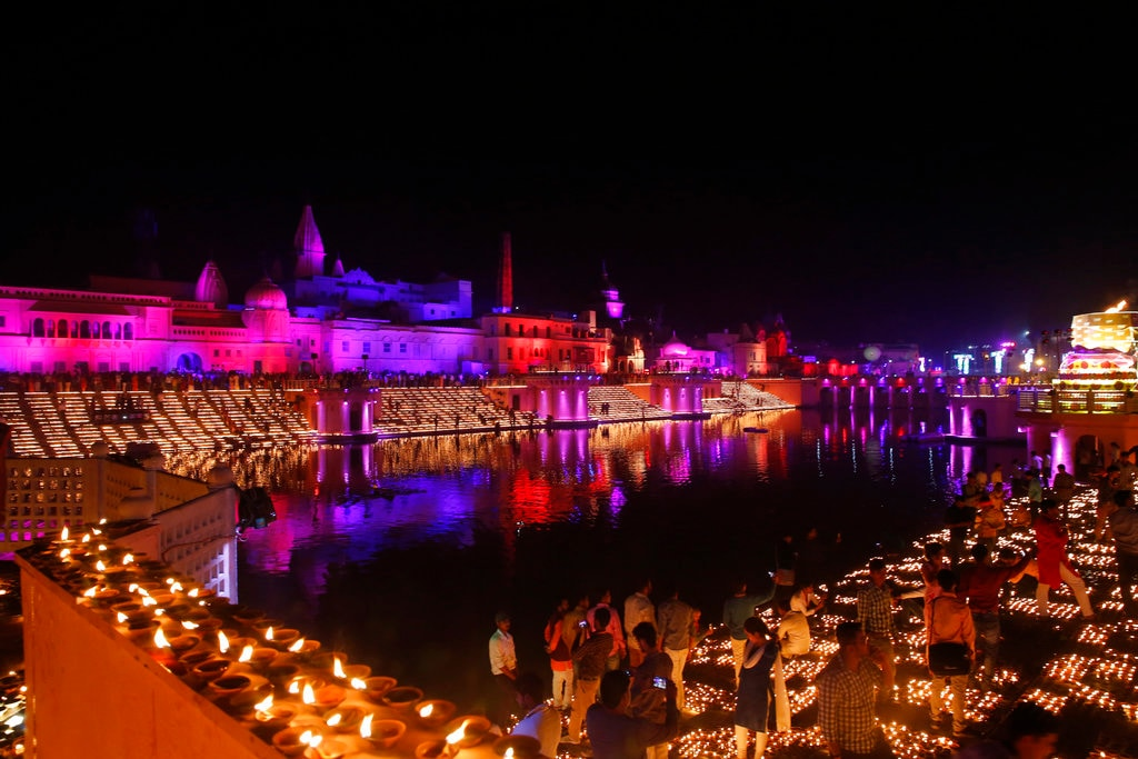 Devotees light earthen lamps on the banks of the River Sarayu as part of Diwali celebrations in Ayodhya, India, India, Tuesday, November 6, 2018. (AP Photo/Rajesh Kumar Singh)