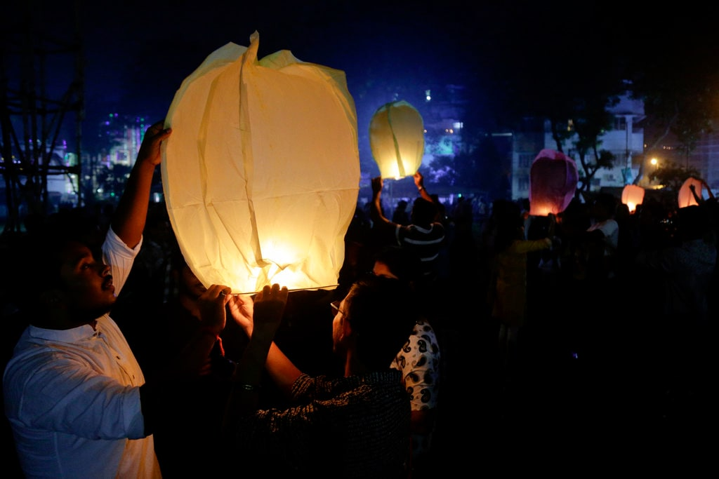 People fly sky lanterns as part of the Diwali celebrations in Kolkata, India, Wednesday, November 7, 2018. (AP Photo/Bikas Das)