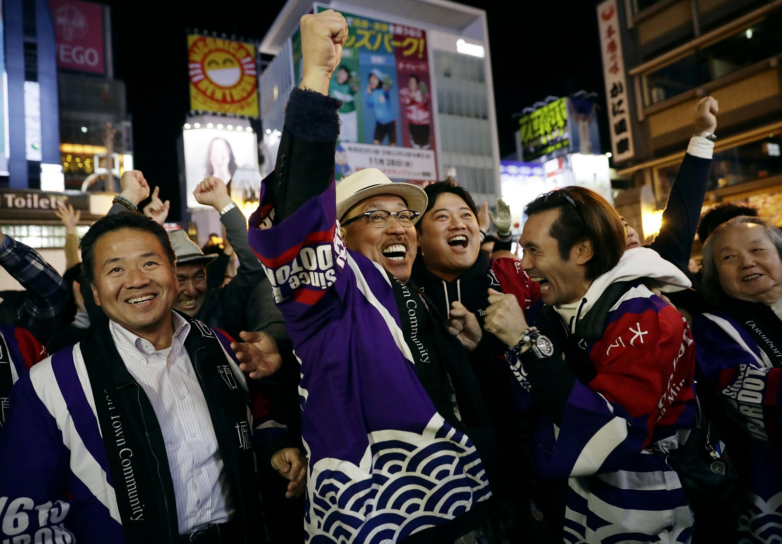 People in Osaka, Japan celebrate after winning the vote at the 164th General Assembly of the Bureau International des Expositions (BIE). Osaka will host the World Expo in 2025, beating out Russia, Azerbaijan for an event. (Kyodo News via AP, File)