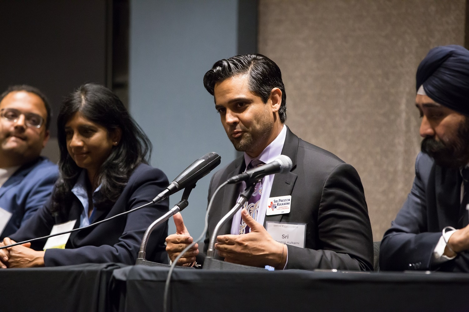 Sri Kulkarni, candidate for U.S. House (TX-22), speaks at Impact Summit, June 7, 2018 in Washington, D.C. with (L-R) Ram Villivalam, candidate for Illinois State Senate; Aruna Miller, former candidate for U.S. House (MD-06); and Ravi Bhalla, Mayor of Hoboken, NJ.