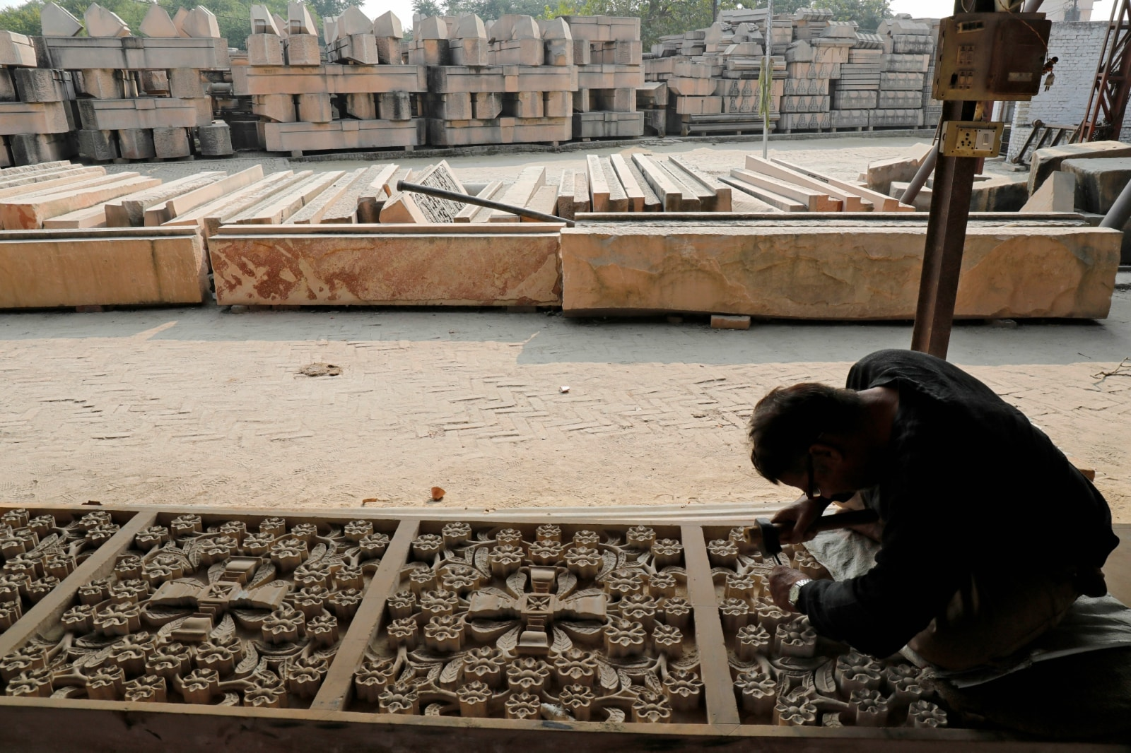 A worker engraves a stone that Hindu groups say will be used to build a Ram temple at a disputed religious site in Ayodhya, Uttar Pradesh, India. November 6, 2018. REUTERS/Pawan Kumar