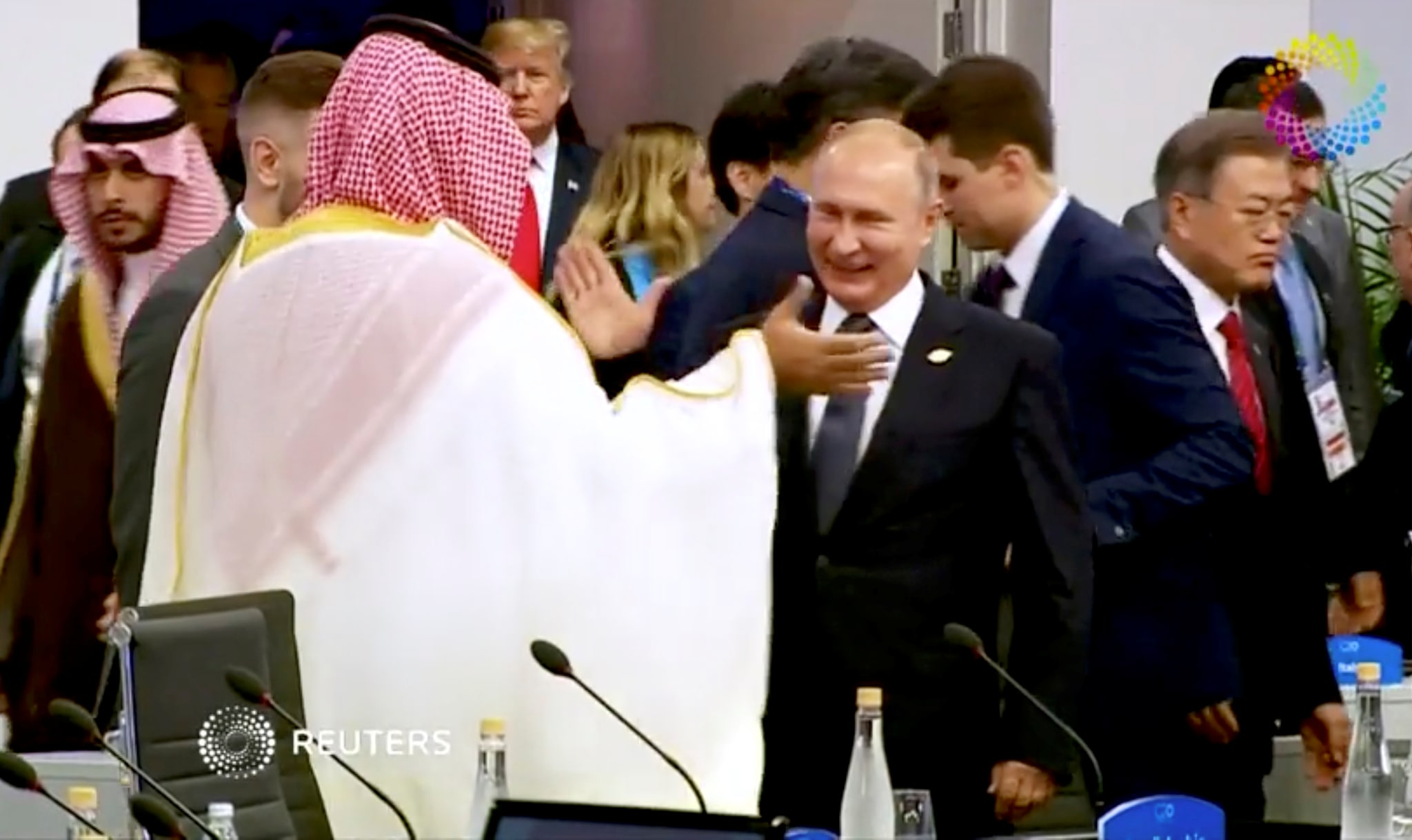 Saudi Arabia's Crown Prince Mohammed bin Salman greets Russia's President Vladimir Putin during the opening of the G20 leaders summit in Buenos Aires, Argentina November 30, 2018 in this picture taken from video. Reuters TV Summit Pool via REUTERS