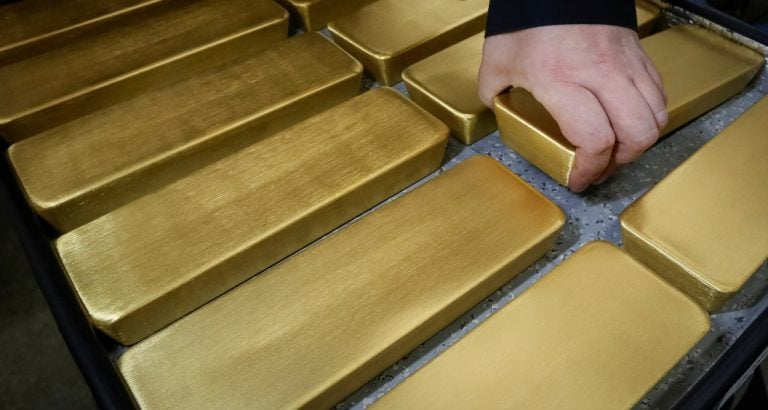 Gold slips as dollar bounces on global trade jitters