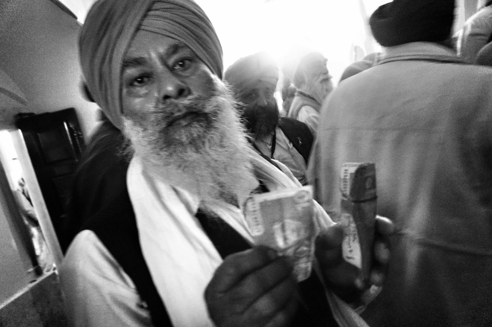 Baldev Singh Rai from Himachal Pradesh changed Indian rupee to Pakistani rupee for using it for donation at the 'Darbar Sahib' in Kartarpur, Pakistan.