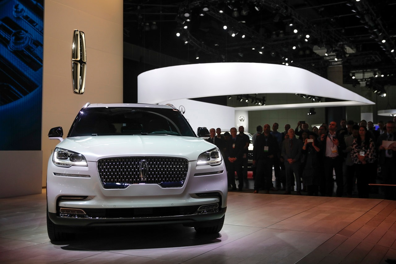 Attendees gather near the 2020 Lincoln Aviator during a news conference at the Los Angeles Auto Show Wednesday, Nov. 28, 2018, in Los Angeles. (AP Photo/Jae C. Hong)
