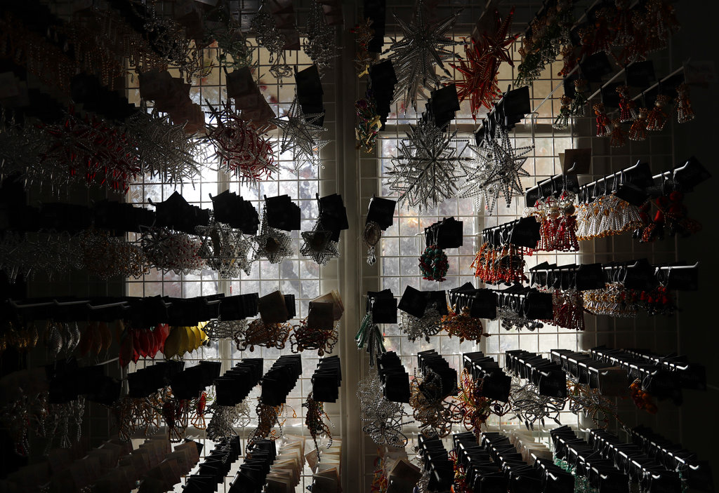 Traditional glass Christmas decorations are displayed in a shop window in the village of Ponikla, Czech Republic. Wednesday, November 28, 2018. (AP Photo/Petr David Josek)