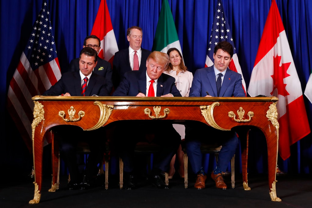 US President Donald Trump, Canada's Prime Minister Justin Trudeau, right, and Mexico's President Enrique Pena Nieto, left, participate in the USMCA signing ceremony, Friday, November 30, 2018 in Buenos Aires, Argentina. (AP Photo/Pablo Martinez Monsivais)