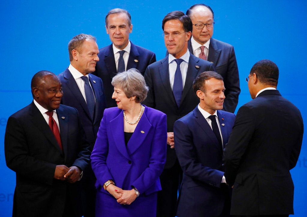 World leaders gather for a group photo at the start of the G20 Leader's Summit at the Costa Salguero Center in Buenos Aires, Argentina, Friday, November 30, 2018. Front, from left, are South Africa's President Cyril Ramaphosa, Britain's Prime Minister Theresa May, France's President Emmanuel Macron, and Senegal's President Macky Sall. Center, from left, are European Council's President Donald Tusk and Netherlands' Prime Minister Mark Rutte. Top, from left, are Mark Carney, President Chair of the Financial Stability Board and World Bank President Jim Yong Kim. (Andres Martinez Casares/Pool Photo via AP)