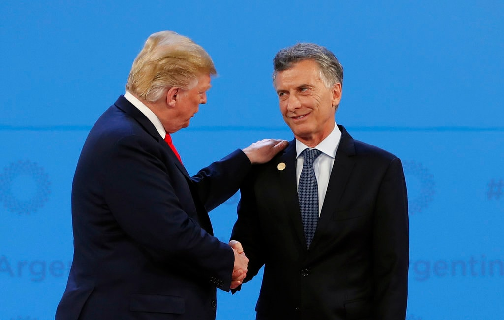 Argentina's President Mauricio Macri, right, welcomes US President Donald Trump to the start of the G20 Leader's Summit at the Costa Salguero Center in Buenos Aires, Argentina, Friday, November 30, 2018. (AP Photo/Ricardo Mazalan)