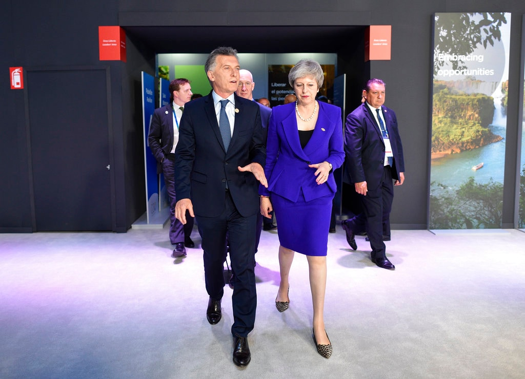 Britain's Prime Minister Theresa May and Argentina's President Mauricio Macri talk during the G20 Leader's Summit at the Costa Salguero Center in Buenos Aires, Argentina, Friday, November 30, 2018. (AP Photo/Gustavo Garello)