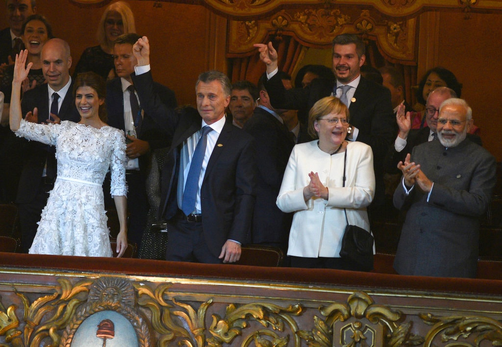 Argentina's first lady Juliana Awada, left, Argentina's President Mauircio Macri, second left, German Chancellor Angela Merkel, second right, and Prime Minister Narendra Modi, right, cheer during a cultural event at the Colon Theater in Buenos Aires, Argentina, Friday, November 30, 2018. (G20 Press Office via AP)