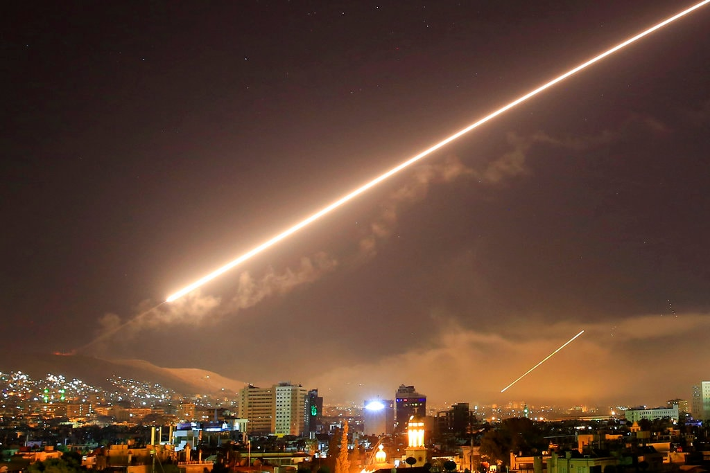 Surface to air missile fire lights up the sky over Damascus at the US launches an attack on Syria early on April 14, 2018. US President Donald Trump ordered the airstrikes in retaliation for Syria's alleged use of chemical weapons. (AP Photo/Hassan Ammar)