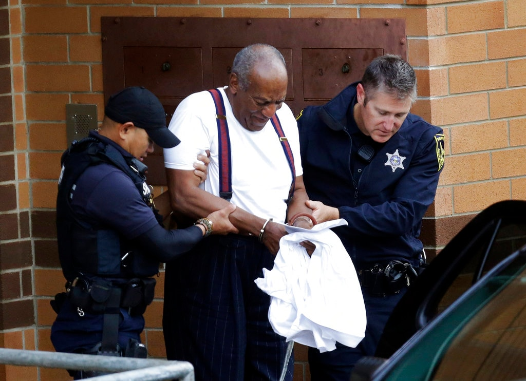 Bill Cosby is escorted out of the Montgomery County Correctional Facility in Eagleville, Pennsylvania, on September 25, 2018, following his sentencing to a three-to-10-year prison sentence for sexual assault. (AP Photo/Jacqueline Larma)