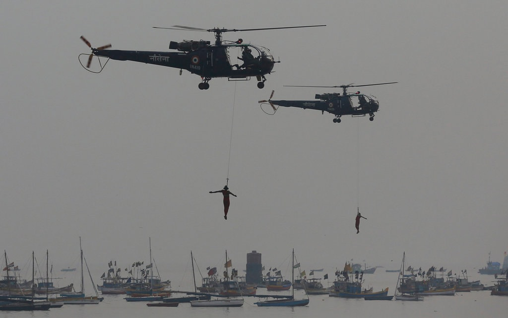 Navy personnel display their skills during Naval Day celebrations at the Arabian Sea in Mumbai, Sunday, December 2, 2018. (AP Photo/Rafiq Maqbool)