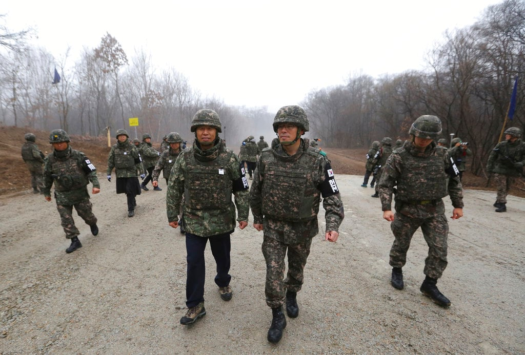 South Korean Gangwon Province governor Choi Moon-soon, center left, is escorted by South Korean army soldiers as he visits inside the Demilitarised Zone (DMZ) in the central section of the inter-Korean border in Cheorwon, South Korea. South Korea's president says US President Donald Trump told him he has a