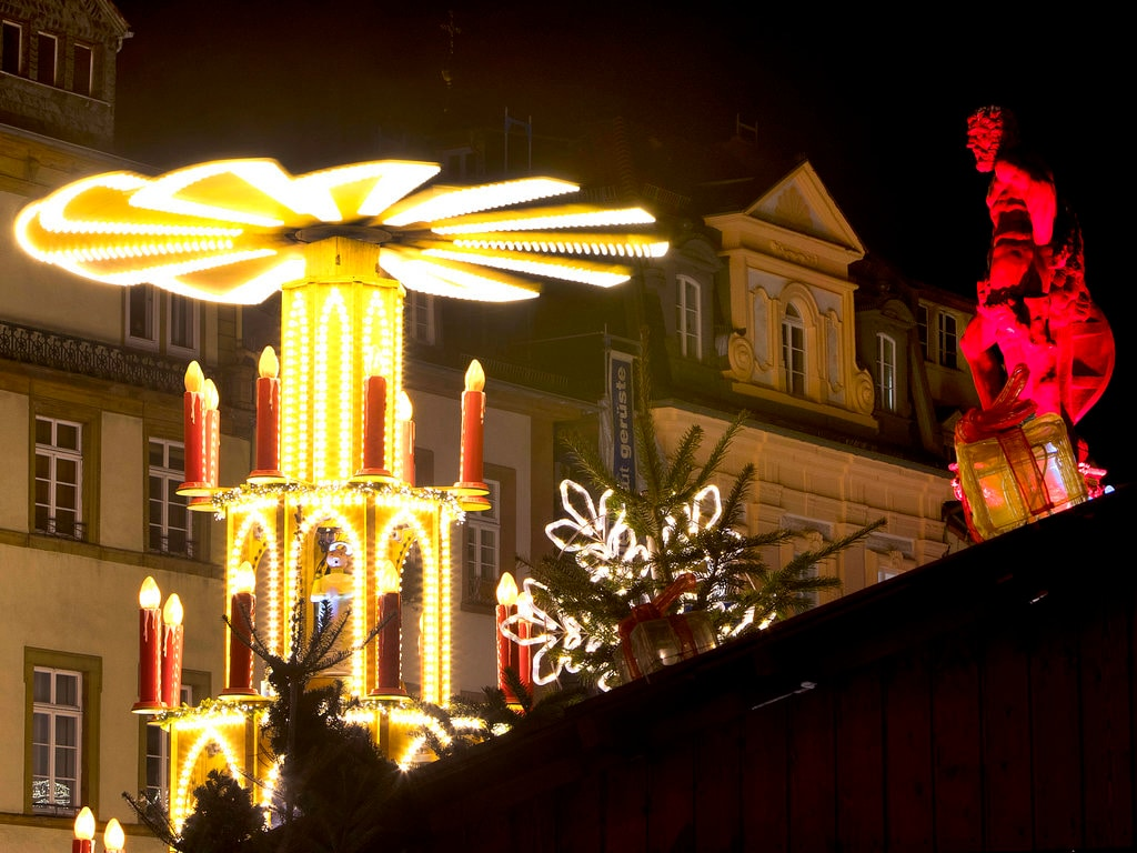 A pyramid and an illuminated statue are seen at the traditional Christmas market in Heidelberg, Germany. Tuesday, December 4, 2018. (AP Photo/Michael Probst)