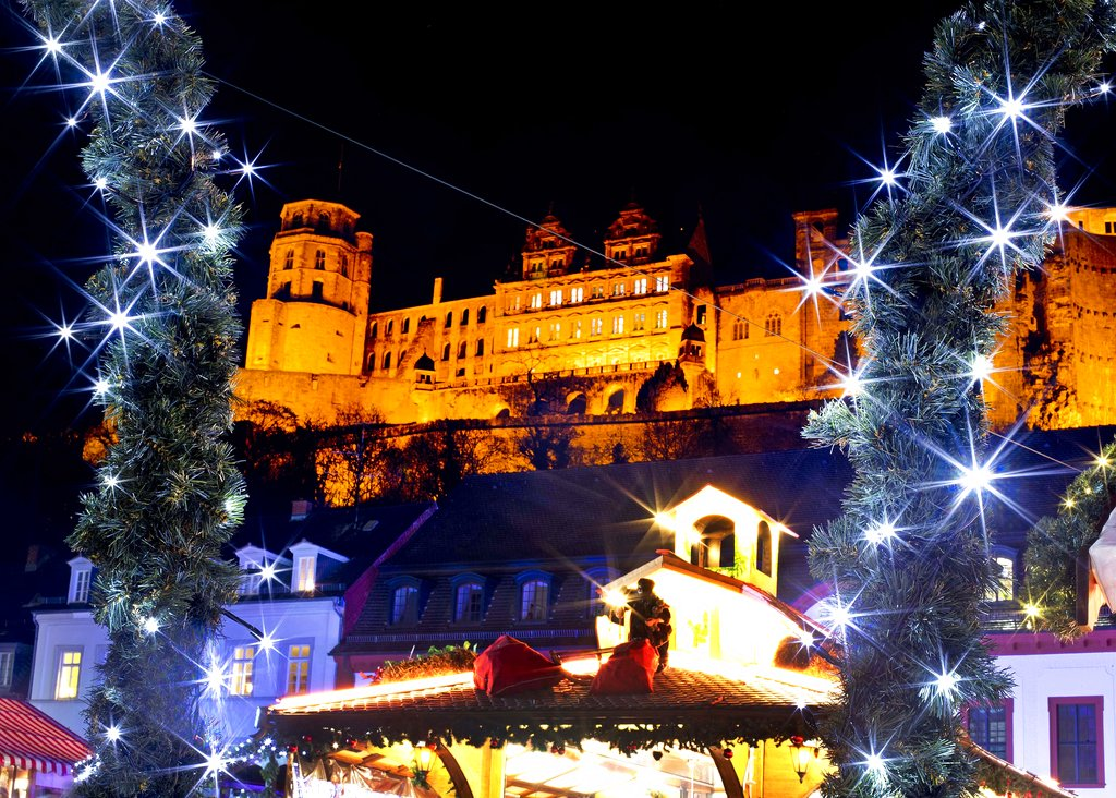 Lights shine in front of the castle at the traditional Christmas market in Heidelberg, Germany. Tuesday, December 4, 2018. (AP Photo/Michael Probst)