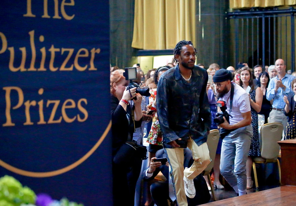 In this May 30, 2018 file photo, Kendrick Lamar walks onto the stage to accept the Pulitzer Prize for music for his album
