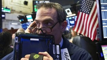 Wall Street clings to gains on trade hopes