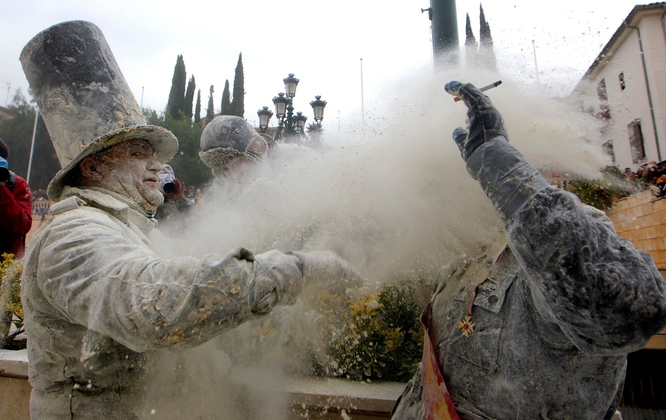 Revellers play with flour as part of the festival .(AP Photo/Alberto Saiz)