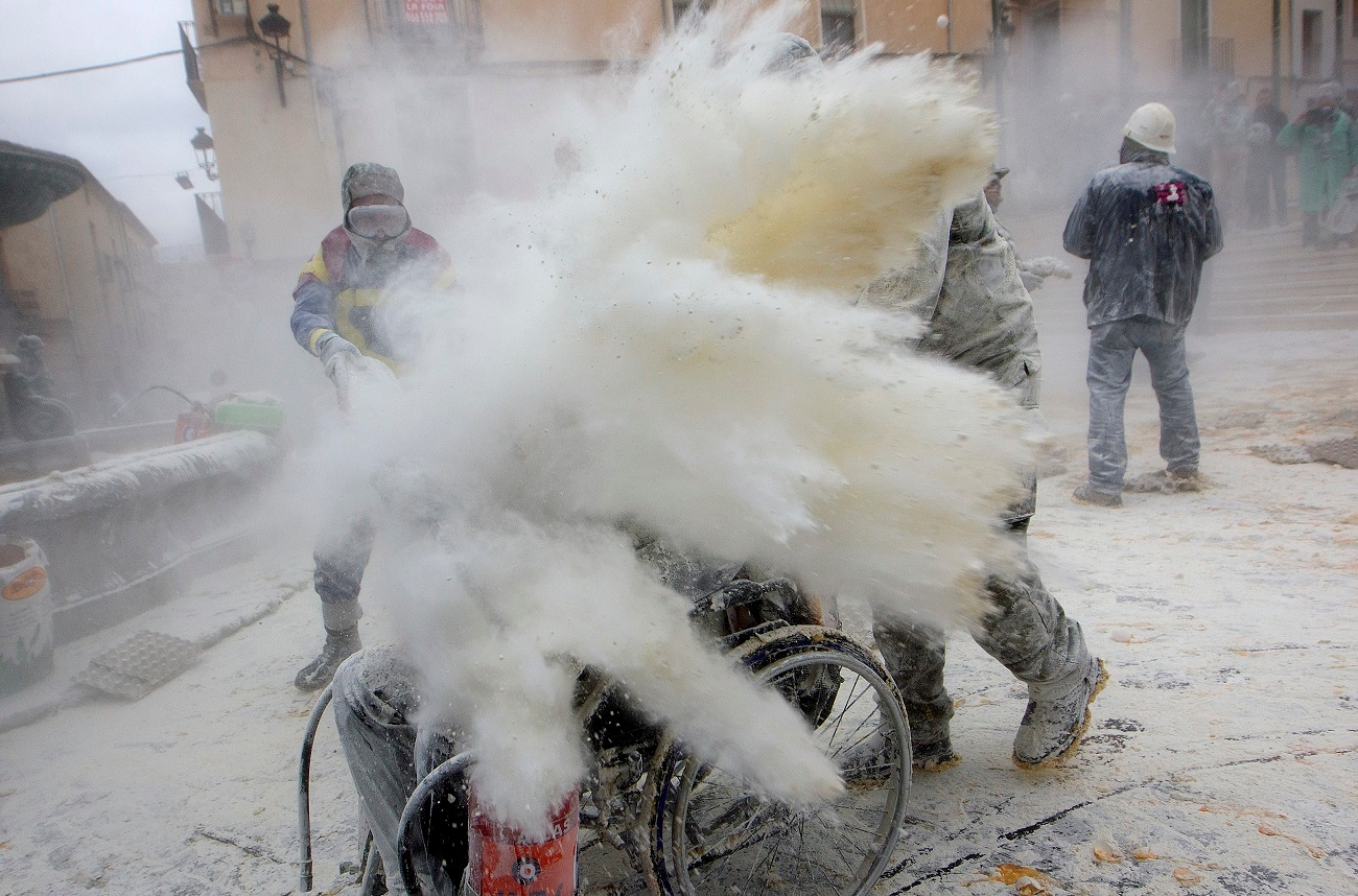 Revellers through flour at each other as part of the festival. (AP Photo/Alberto Saiz)