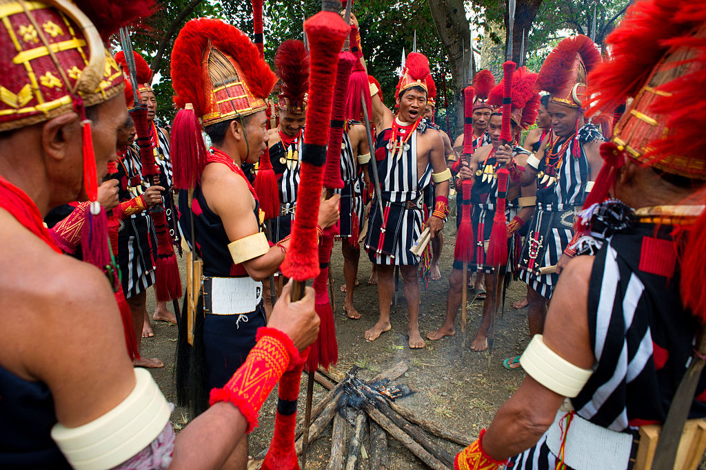To encourage inter-tribal interaction and to promote cultural heritage of all the sixteen tribes of Nagaland, the Government of Nagaland organises the Hornbill Festival every year in the first week of December. The festival was first held in the year 2000. It is named after the Indian hornbill, the large and colourful bird which is much admired by the tribes of the state. Hornbill festival is held at the Naga Heritage Village in Kisama, some twelve kilometers away from the state capital, Kohima. All the tribes of Nagaland take part in this festival. For visitors the festival offers an opportunity to understand the tribal culture of Nagaland. The traditional Naga Morungs and the sale of indigenous artifacts provide additional attraction. (Photo by Subhendu Sarkar/LightRocket via Getty Images)