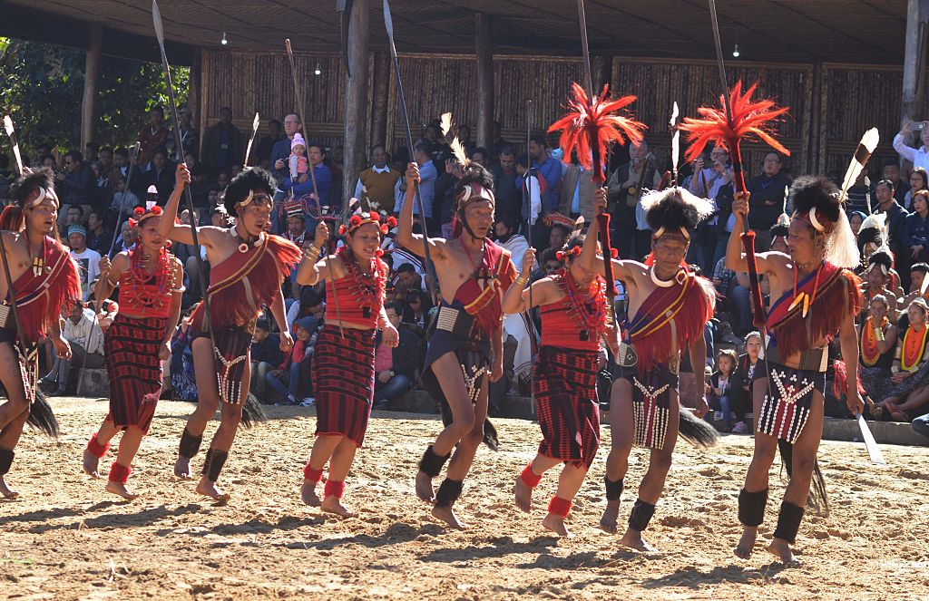 Naga tribesmen perform a cultural dance on the last day of the 10 day long Hornbill festival at the Naga Heritage village Kisama, some 12 kms away from Kohima, the capital city of Nagaland. The Hornbill Festival which celebrates from December 1-10 celebrates the cultural heritage of the Nagas. (Photo by Caisii Mao/NurPhoto via Getty Images)