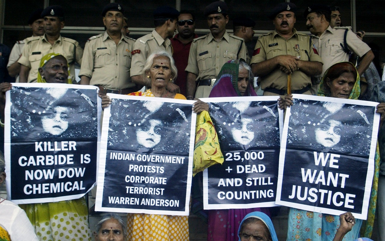 Victims of Bhopal gas tragedy hold posters during a demonstration outside a court in the city of Bhopal on June 7, 2010. REUTERS/Raj Patidar