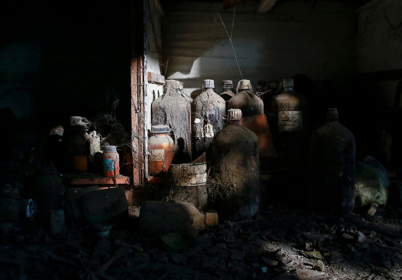 Thick dust covers chemical bottles in a laboratory at the abandoned former Union Carbide pesticide plant in Bhopal, November 14, 2014. REUTERS/Danish Siddiqui
