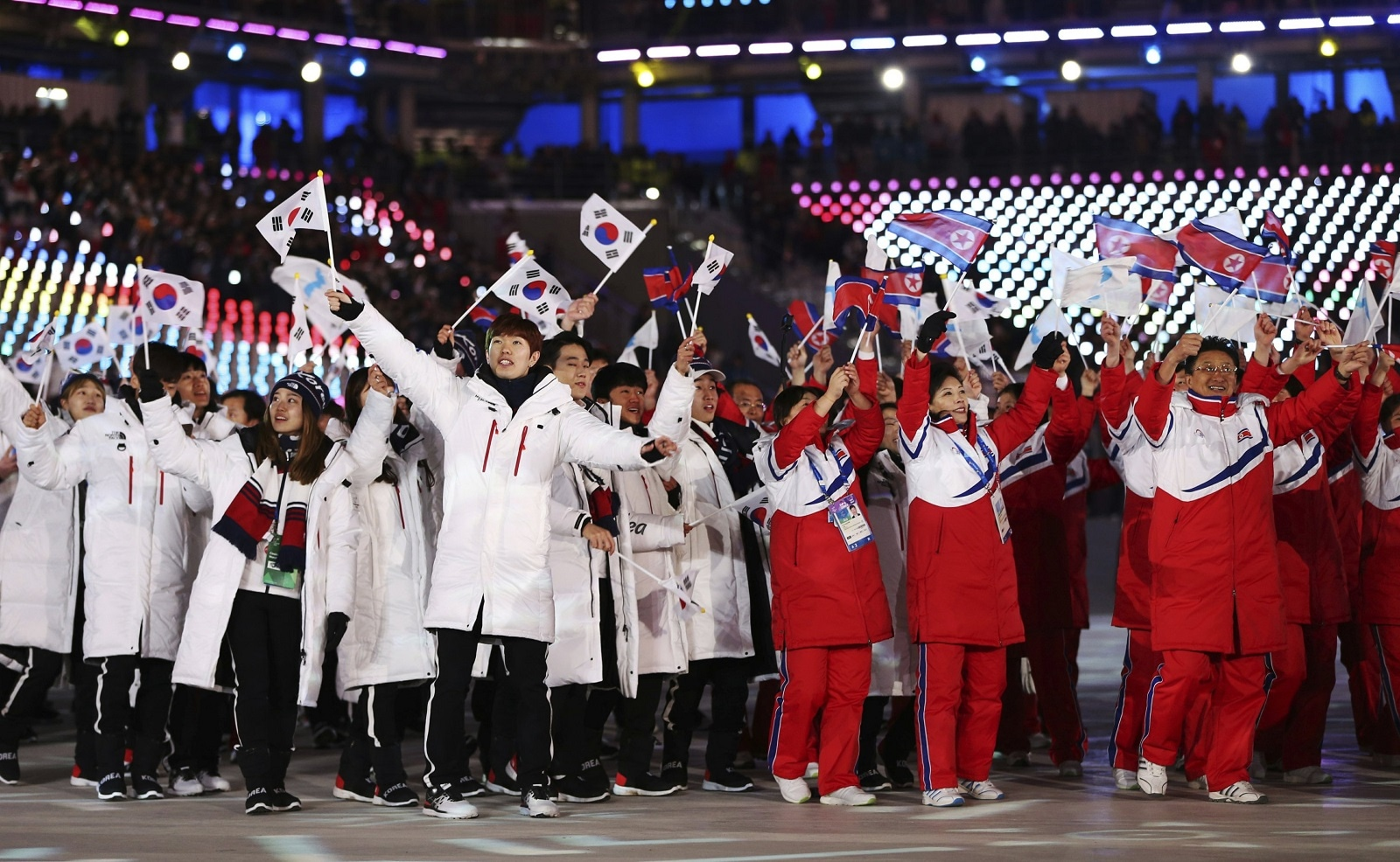 North and South Koreans wave flags together during the closing ceremony of the 2018 Winter Olympics in Pyeongchang, South Korea, on February 25, 2018. (AP Photo/Natacha Pisarenko)