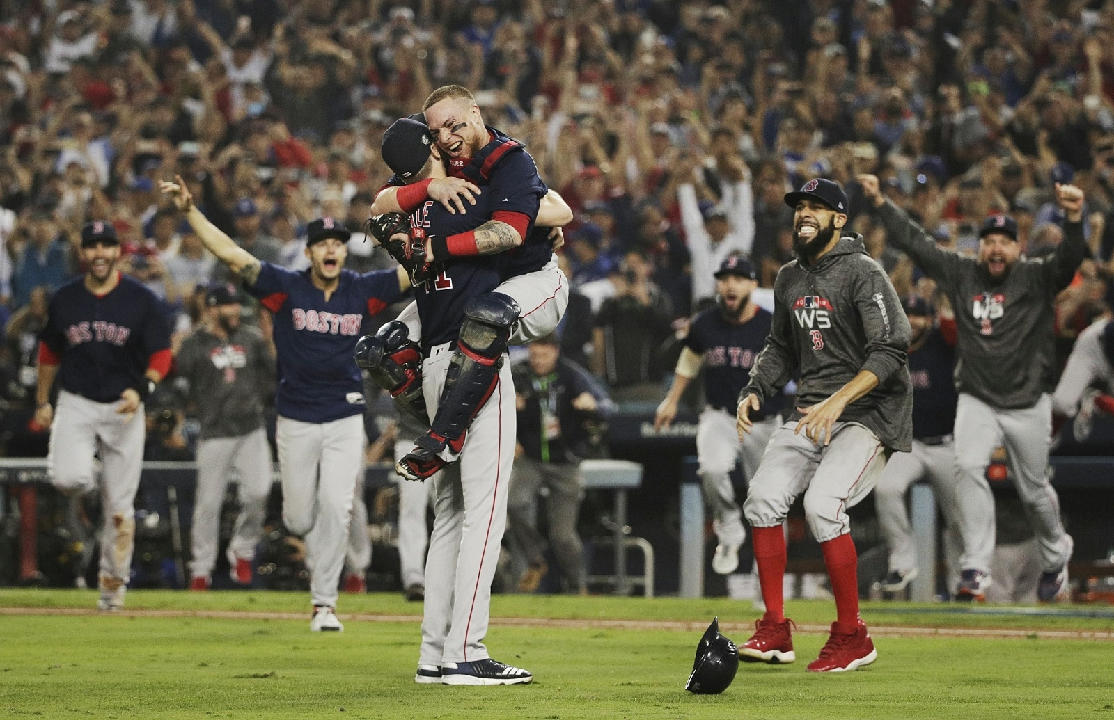 The Boston Red Sox celebrate after Game 5 of baseball's World Series against the Los Angeles Dodgers on October 28, 2018, in Los Angeles. The Red Sox won the game 5-1 to win the series 4 games to 1. (AP Photo/Jae C. Hong)