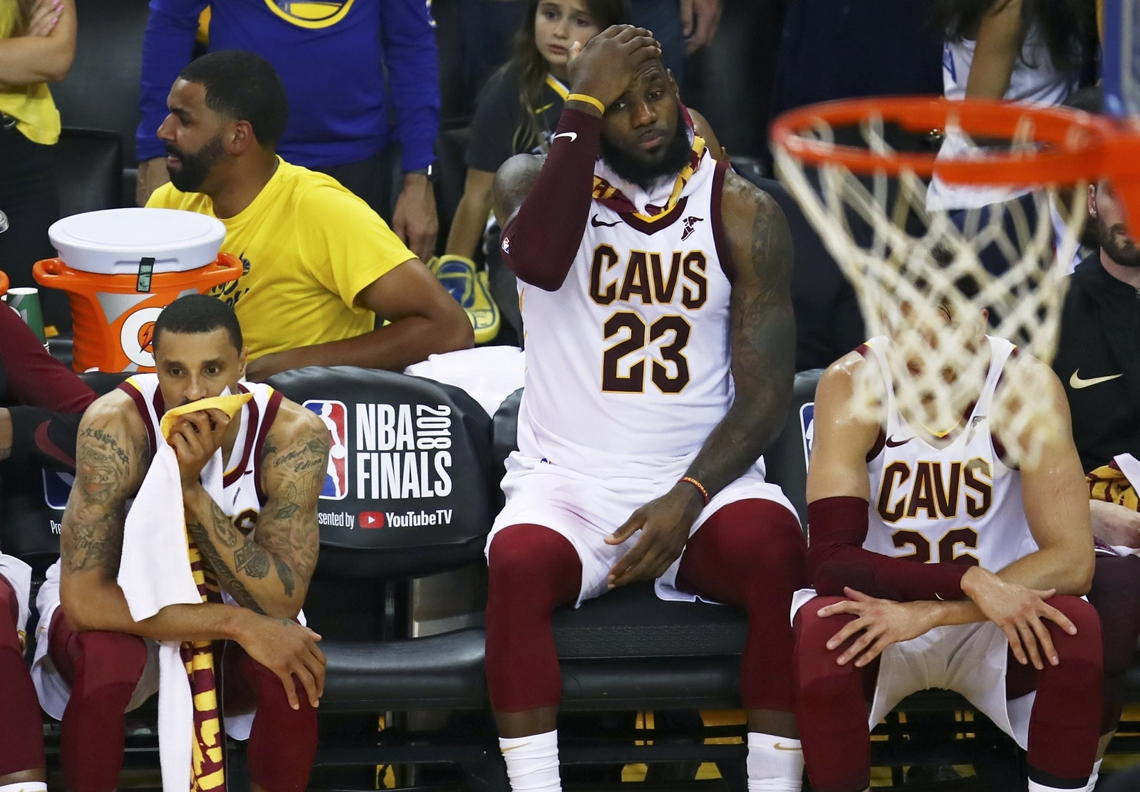 Cleveland Cavaliers forward LeBron James (23) sits on the bench between guards George Hill, left, and Kyle Korver during the second half of Game 2 of basketball's NBA Finals against the Golden State Warriors in Oakland, California, on June 3, 2018. The Warriors won 122-103. (AP Photo/Ben Margot)