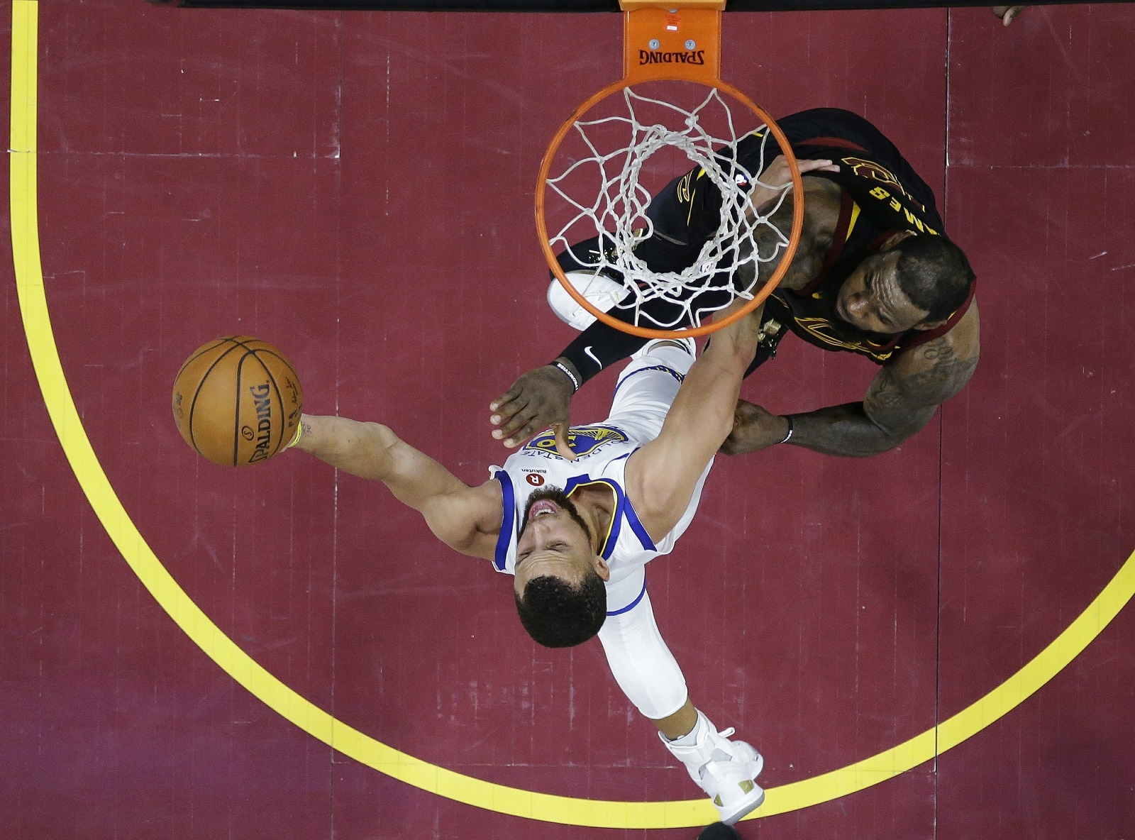 Golden State Warriors' Stephen Curry shoots against Cleveland Cavaliers' LeBron James during the second half of Game 4 of basketball's NBA Finals on June 8, 2018, in Cleveland. (AP Photo/Carlos Osorio)