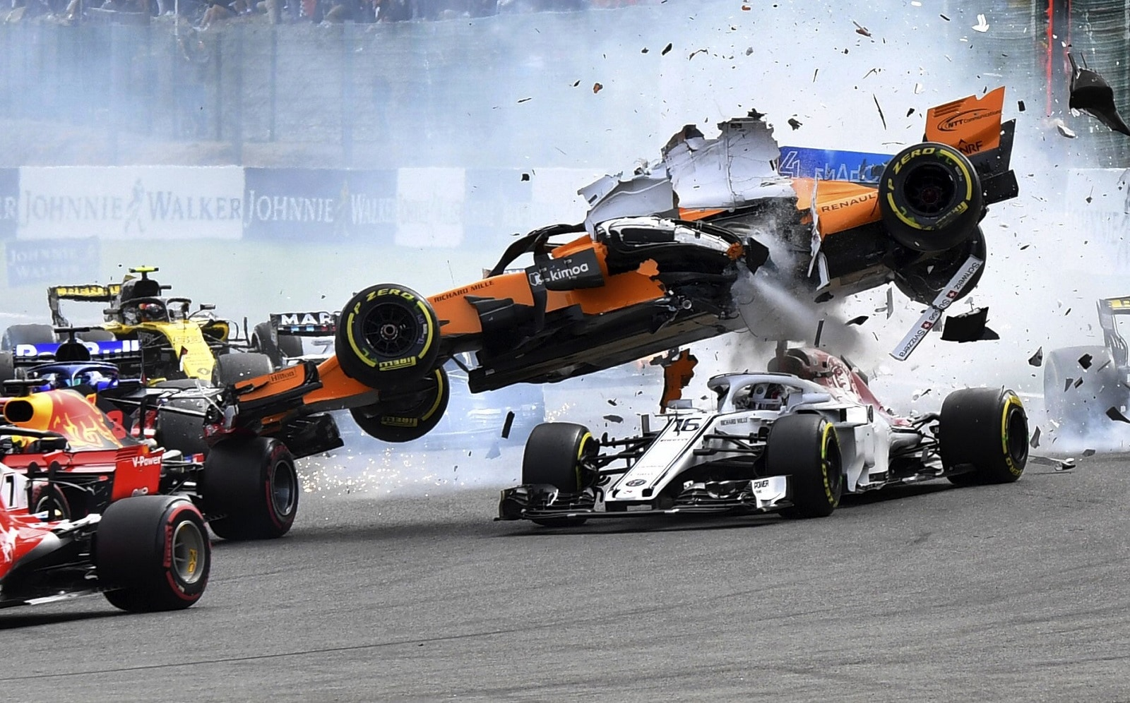 Mclaren driver Fernando Alonso of Spain goes over the top of Sauber driver Charles Leclerc of Monaco at the start of the Belgian Formula One Grand Prix in Spa-Francorchamps, Belgium, on August 26, 2018. (AP Photo/Geert Vanden Wijngaert)