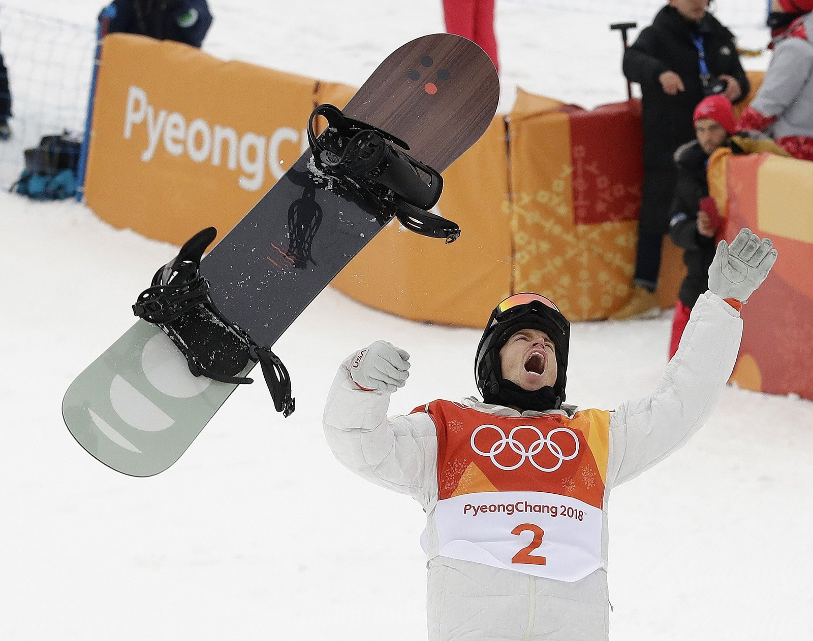 Shaun White, of the United States, celebrates winning gold after his run during the men's halfpipe finals at the 2018 Winter Olympics in Pyeongchang, South Korea, on February 14, 2018. (AP Photo/Gregory Bull)