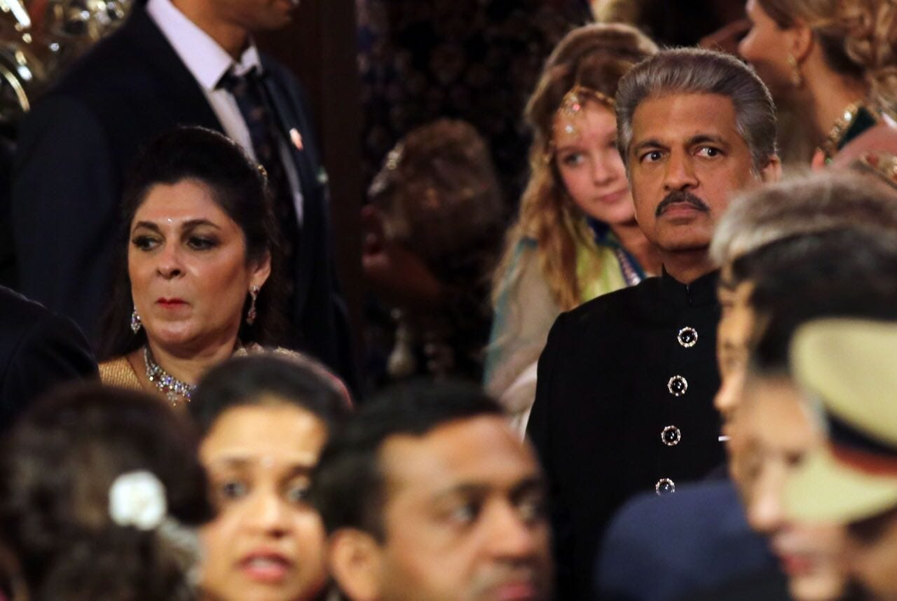 Industrialist Anand Mahindra arrives for the wedding along with his wife.
