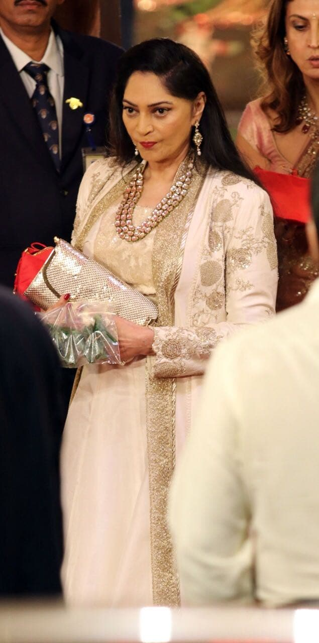 Bollywood actress Simi Garewal arrives for the wedding ceremony in Mumbai.