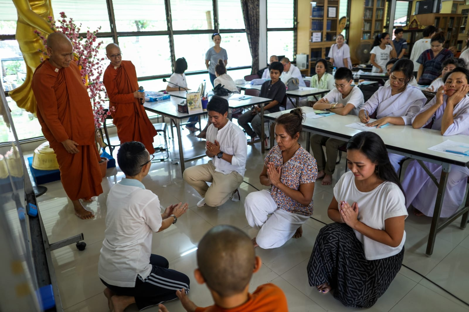 Thai women devotees practice during a first orientation to become Buddhist novice monks at the Songdhammakalyani monastery, Nakhon Pathom province, Thailand, November 17, 2018. REUTERS/Athit Perawongmetha