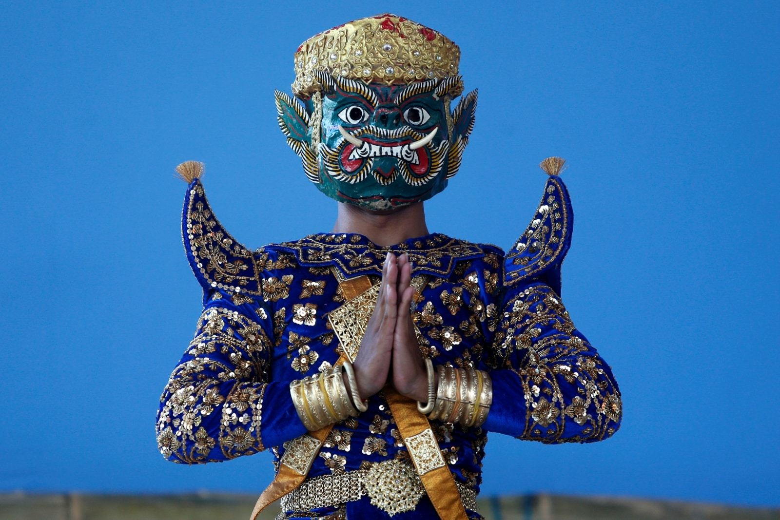 A dancer with elaborate costume posses before a performance of masked theater known as Lakhon Khol, at the Wat Svay Andet Buddhist temple in Kandal province, Cambodia December 16, 2018. REUTERS/Samrang Pring