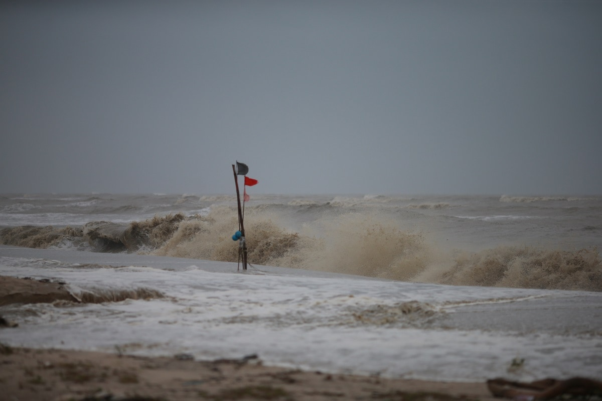 A red flag, warning of dangerous conditions, is seen at a beach as tropical storm Pabuk approaches the southern province of Nakhon Si Thammarat, Thailand. (REUTERS/Krittapas Chaipimon)