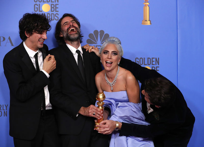 (From L) Anthony Rossomando, Andrew Wyatt, Lady Gaga and Mark Ronson pose backstage with their Best Original Song Motion Picture award for