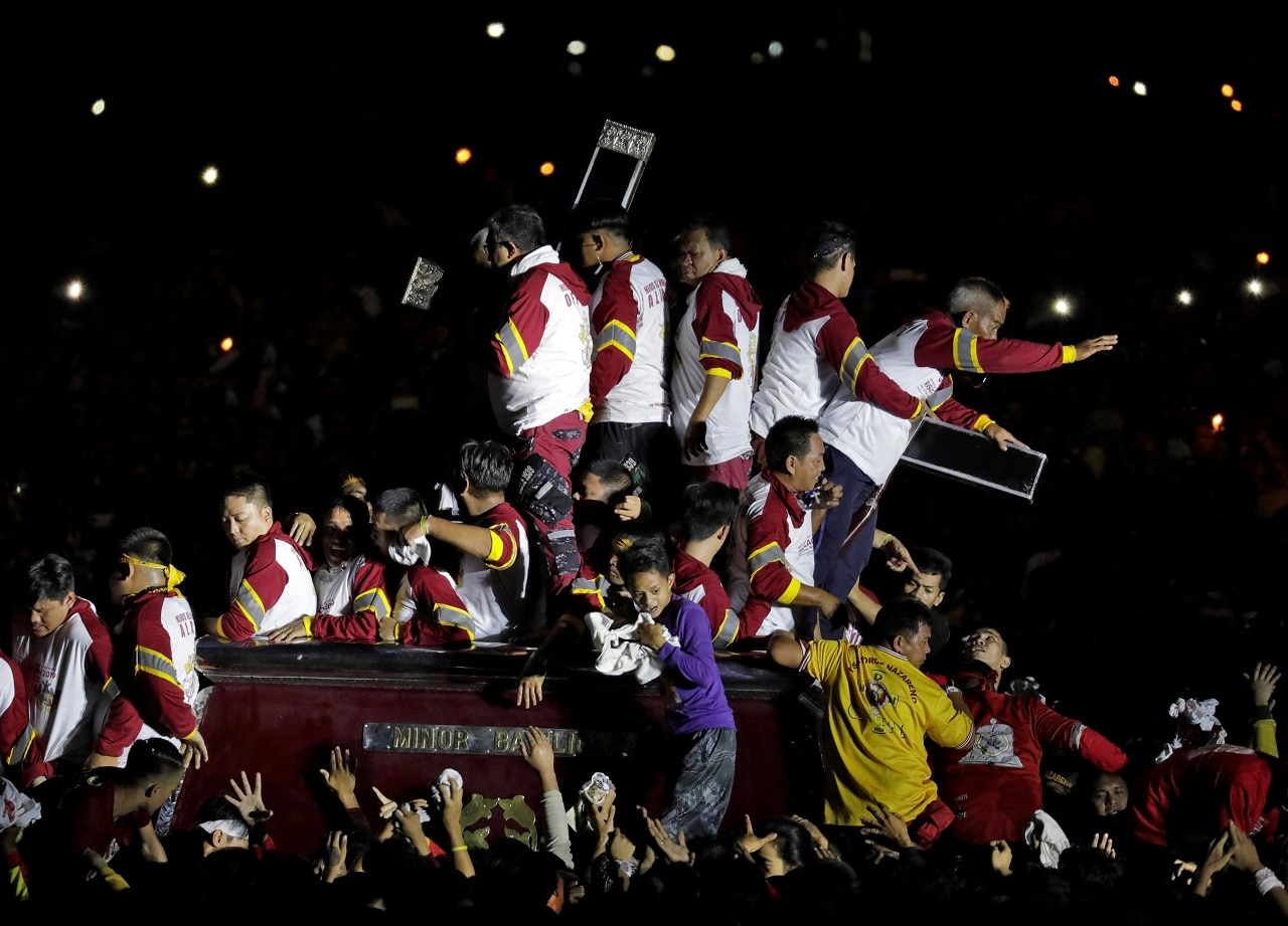 Catholic devotees jostle to touch the statue of the Black Nazarene on its feast day in Manila, Philippines, January 9, 2019. It is not known why the statue, which was carved in Mexico, turned black. There are myths that the original statue donated by Spanish priests was burned as a fire erupted on the ship that carried it to the Philippines in the early 17th century.. REUTERS/Eloisa Lopez