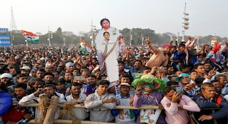 A supporter holds a cut-out of Mamata Banerjee, Chief Minister of the state of West Bengal,