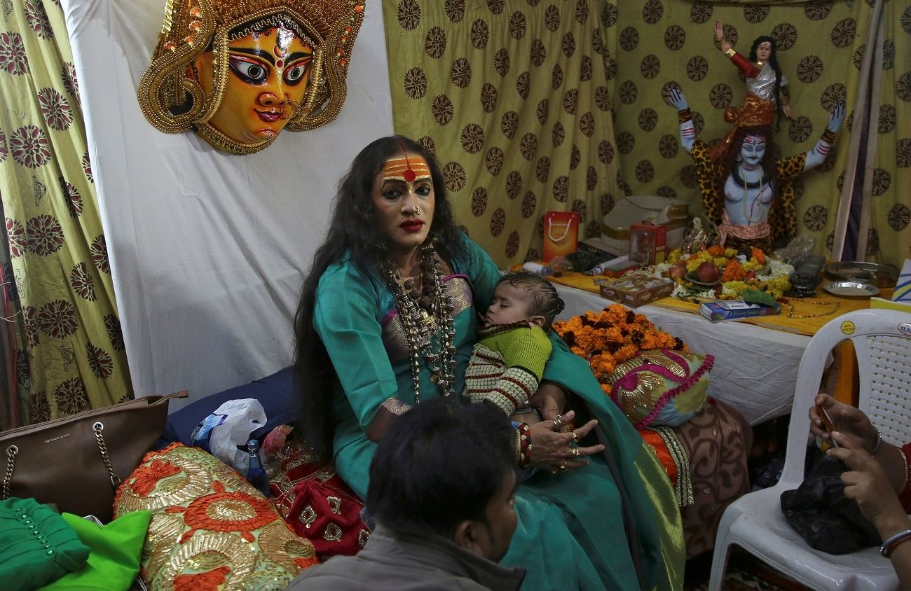 Laxmi Narayan Tripathi holds a baby of her follower. (REUTERS/Danish Siddiqui/Files)