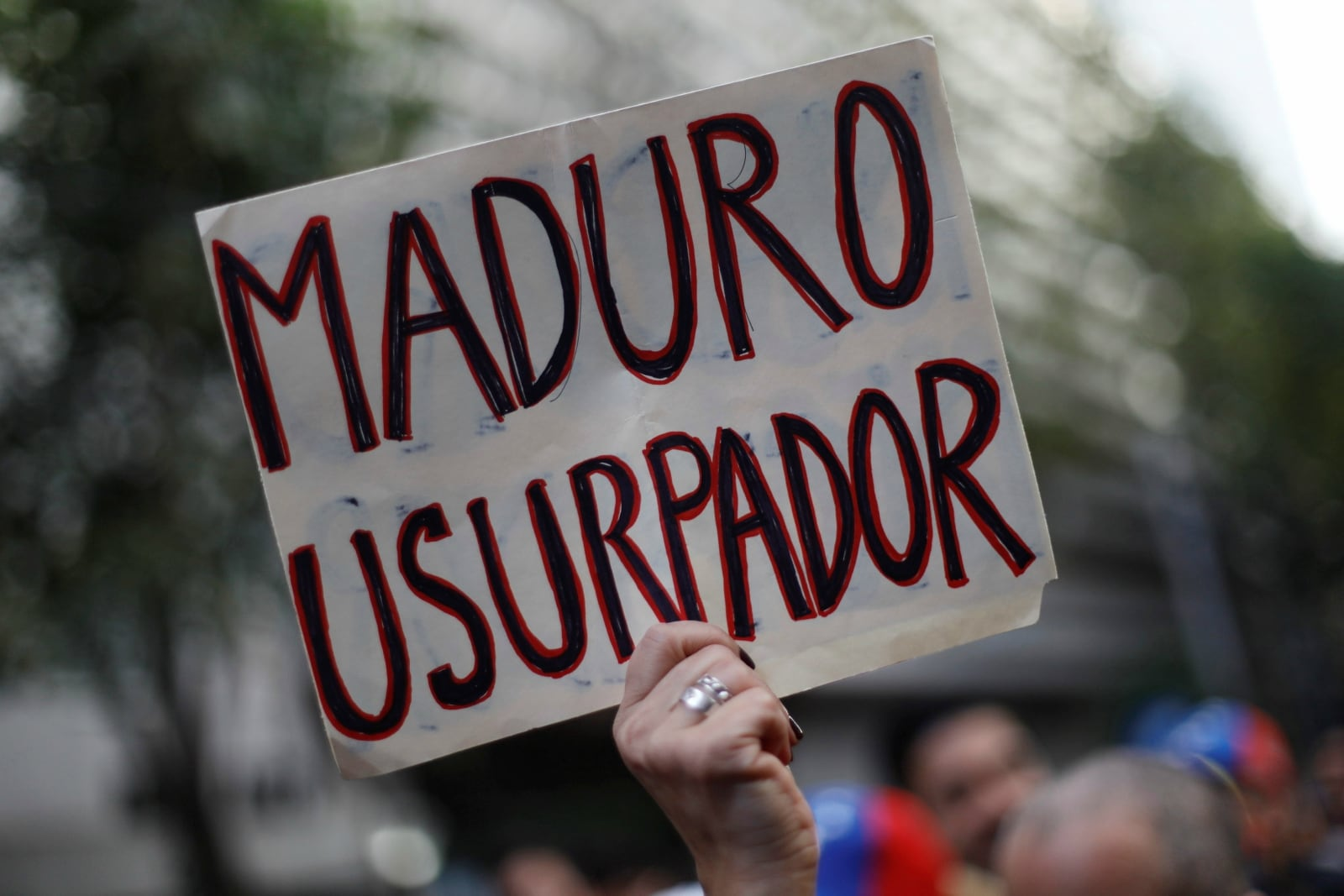 A woman holds a sign as she gathers in support of Venezuela's opposition leader Juan Guaido outside the Embassy of Venezuela in Mexico City, Mexico January 23, 2019. The sign reads,