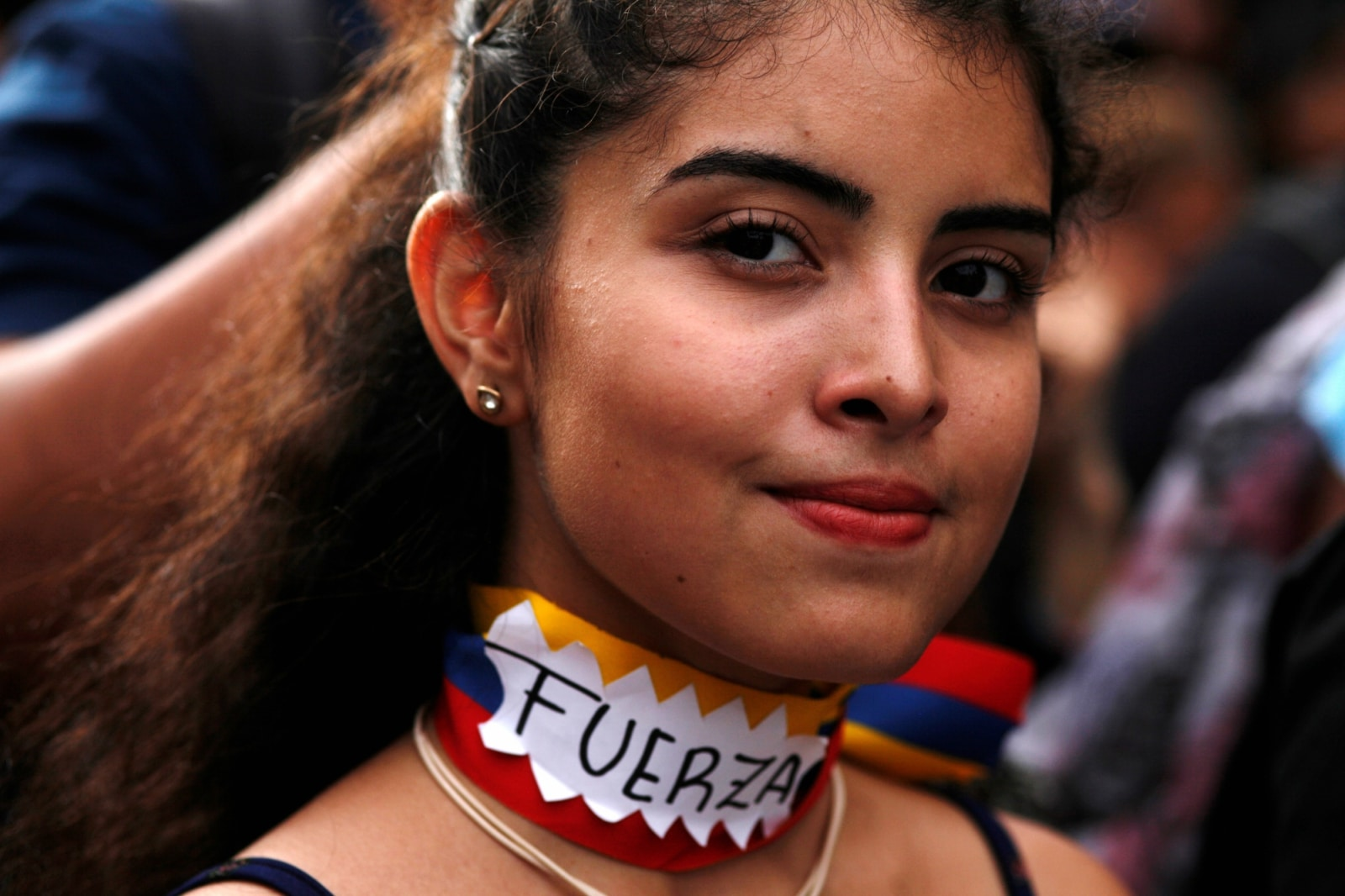 A woman attends a gathering in support of Venezuela's opposition leader Juan Guaido on the Vatican Square in Buenos Aires, Argentina January 23, 2019.The sign reads: